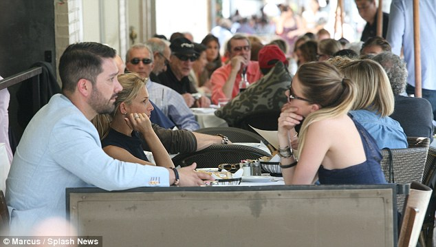 Is she gushing? Amber Heard went out for lunch on Friday in Beverly Hills with a male friend, perhaps to de-brief over her recent public couples-outing with Johnny Depp
