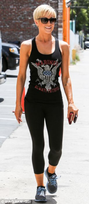 Fabulous form: The country singer showed off her shapely physique in black leggings and tank top