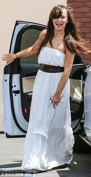 Like a gypsy: Karina Smirnoff was light and airy in a billowy white halter dress as she arrived to Friday's rehearsal