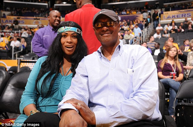 Deal: A lawsuit by the New Jersey auction house claims that Kobe Bryant's mother Pamela Bryant, seen beside his father Joe Bryant, already struck a deal with them for the items' sale