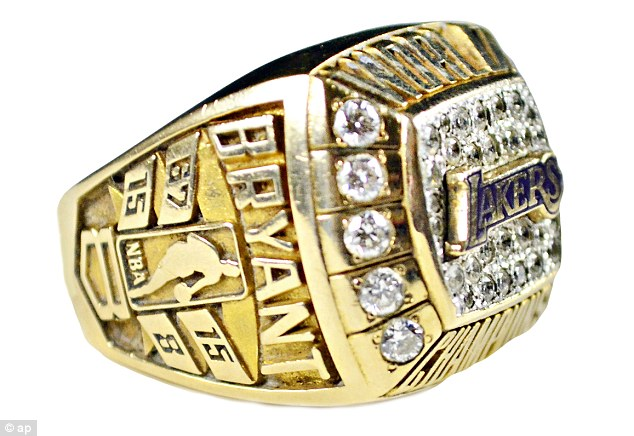 Gifted: A Los Angeles Lakers championship ring given by Kobe to his father Joe Bryant is seen among the items the auction house hopes to sell