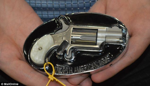 Because who doesn't need a gun that can fit in a belt buckle? Just make sure your gut doesn't hang too far over your belt, or you could blast your family jewels into the next county