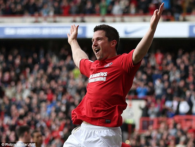 Make mine a double: Yann Kermorgant celebrates the first of two goals to pile misery on Bristol City