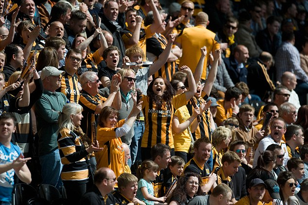 You're getting mauled by the Tigers! City fans celebrate the second goal at the KC Stadium