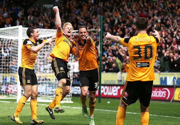 We're back! McShane (second left) celebrates the goal which sees Hull return to the top flight