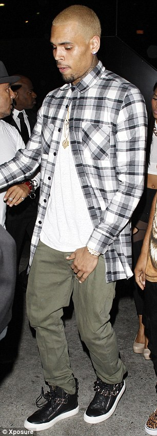 Chris partied the night away...but Rihanna was nowhere to be seen!
