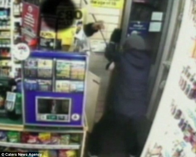 Fleeing: CCTV footage shows Waller running out of the store as Mr Patel jabs him with the weapon from behind the counter