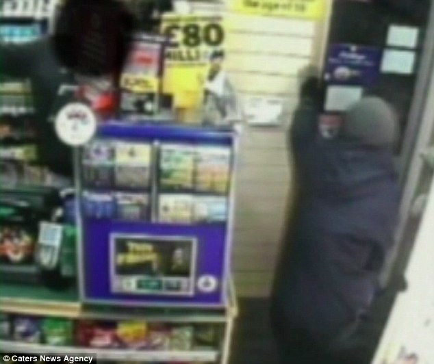 Escape: The robber fled out the door as Mr Patel jabbed him with his own weapon