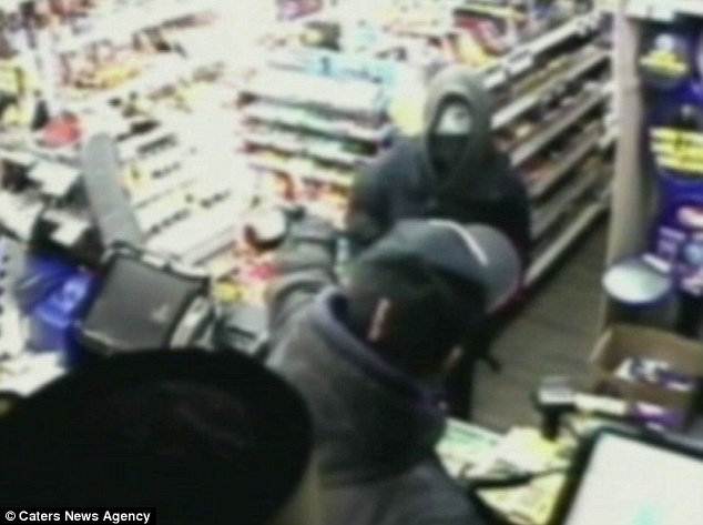 Brave: The footage shows Mr Patel reaching out and grabbing the weapon from Waller