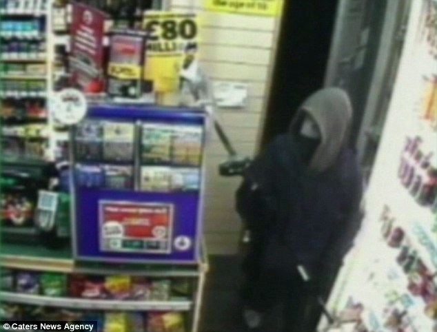 Attack: The Hull University student is seen on CCTV footage entering the Bargain Booze wielding the golf club