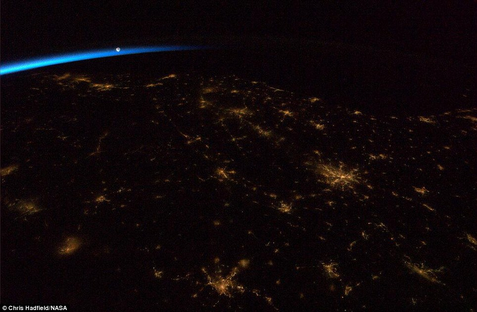 One of Canadian astronaut Chris Hadfield's latest pictures from the International Space Station shows a darkened south-eastern United States just before dawn, with the moon rising above