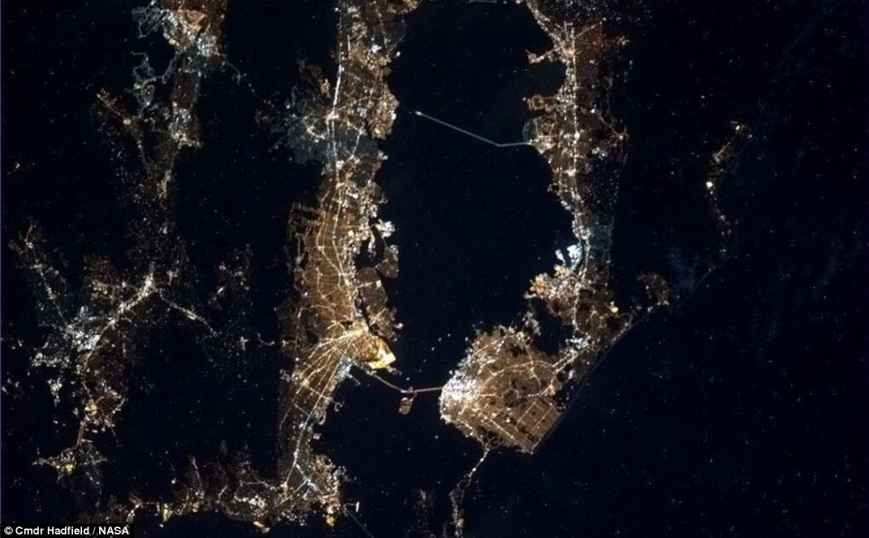 Shining bright: Hadfield says that you can even see the bright lights of Alcatraz in this night time photograph of San Francisco