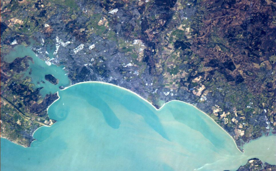 Seaside shot: Most of Commander Hadfield's pictures of the UK were taken at night, but this one shows the beautiful blue sea surrounding the coast of Bournemouth in Hampshire