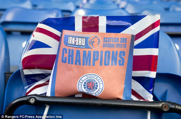 Preparation: Rangers lined the Ibrox seats with Union Jack flags for the title celebrations