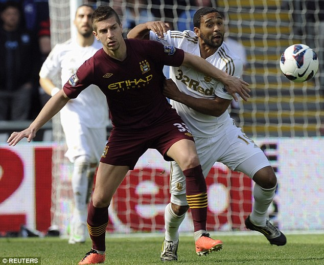 Up for the cup: Matija Nastasic is hoping City can beat Wigan and win the trophy Nemanja Vidic has not won