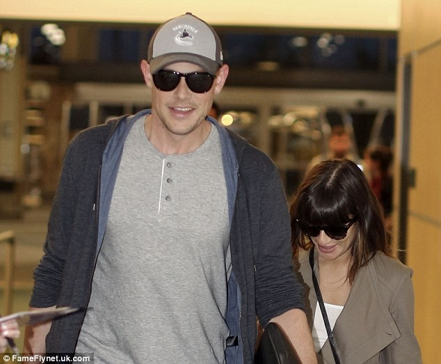 Happy times ahead: The pair seemed happy to be heading back to Los Angeles, California, and putting Cory's tough times behind them