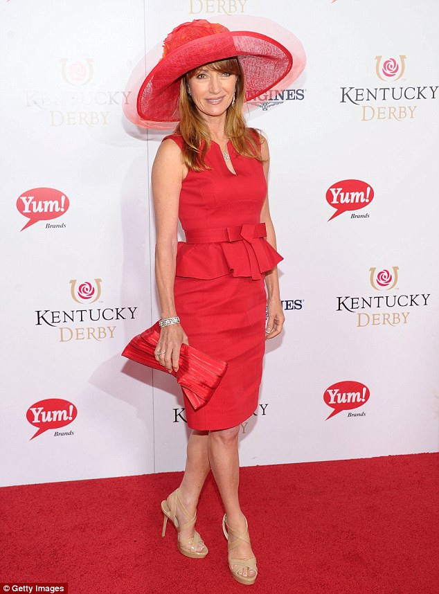 Red carpet queen: Jane Seymour cut a classic figure in a stop-sign red dress at the 139th Kentucky Derby at Churchill Downs in Louisville, Kentucky on Saturday