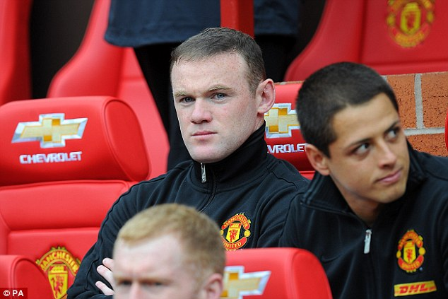 Benched: Wayne Rooney started as a substitute for Manchester United