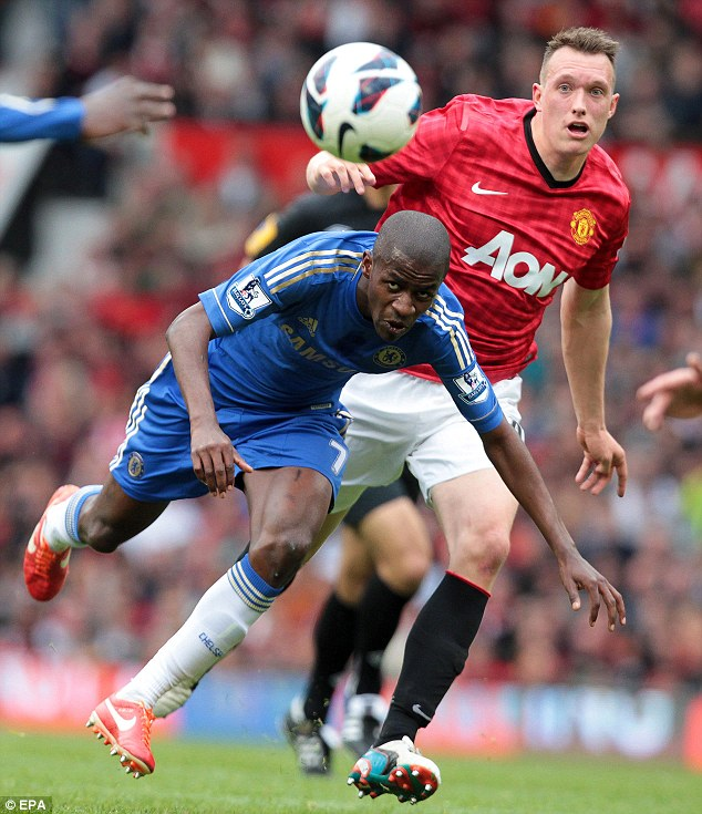 Looking on: Chelsea's Ramires (left) watches the ball along with Manchester United's Phil Jones