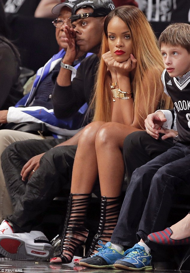 Those aren't basketball shoes: The singer's gladiator-style heels sure attracted attention