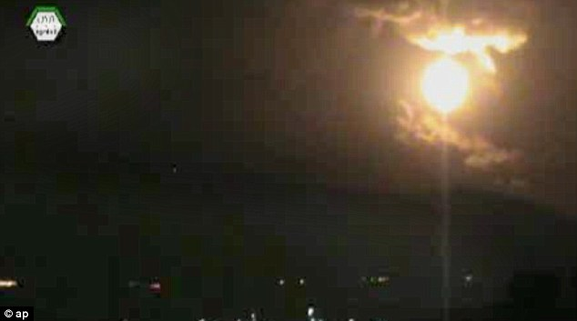 Lit up: The image from an authenticated video obtained from the Ugarit News shows the sky glowing from the explosions
