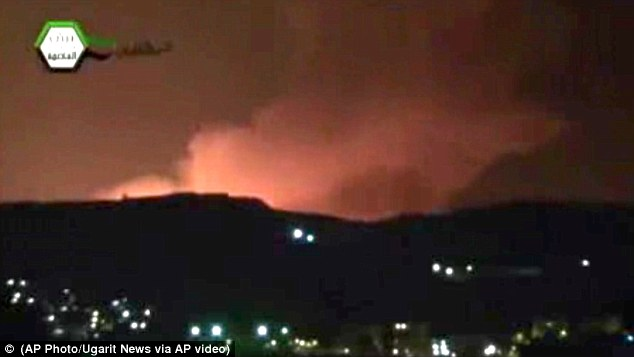 Burning: In an authenticated image taken from video obtained from the Ugarit News, smoke and fire fill the the skyline over Damascus in the early hours of today