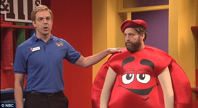 Red hot: The host donned an M&M suit to play a brash employee of one of the candy company's retail outposts