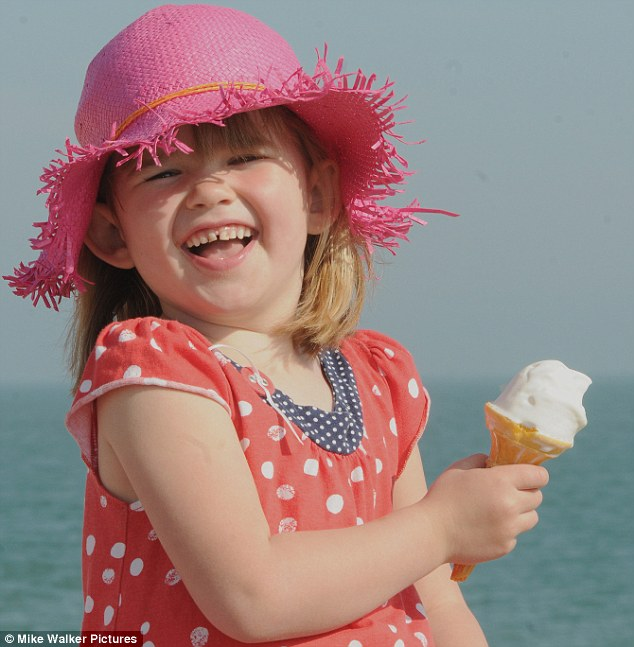 Keeping cool in the sun: Natasha Franks, aged four, enjoys a Mr Whippy ice cream on the sea front at Southsea