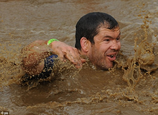 England and British and Irish Lions assistant coach Andy Farrell take part in Tough Mudder 2013 at Boughton House, Kettering