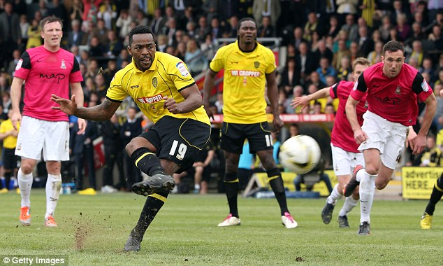Back in the tie: Jacques Maghoma  scores from the penalty spot to give Burton hope