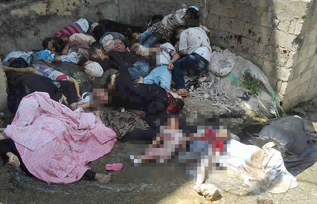 In May, photographs were released of bodies lying in a street in Baniyas after more than 140 people died in a sectarian massacre by pro-Assad forces in Baniyas and Bayda