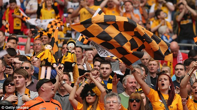 Colourful: Fans with dolls dressed in Newport kit litter the stands