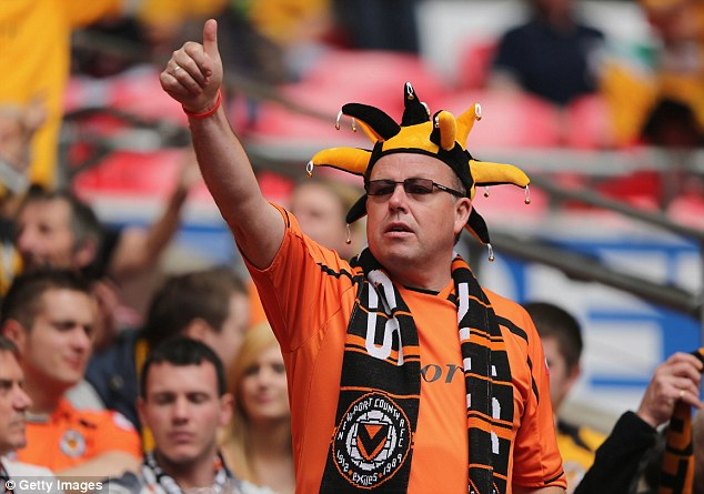 All dressed up: Newport fans enjoying their day out at the home of football