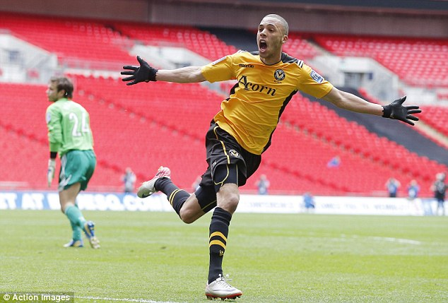 Priceless: Christian Jolley celebrates scoring the goal that gave Newport the lead at Wembley