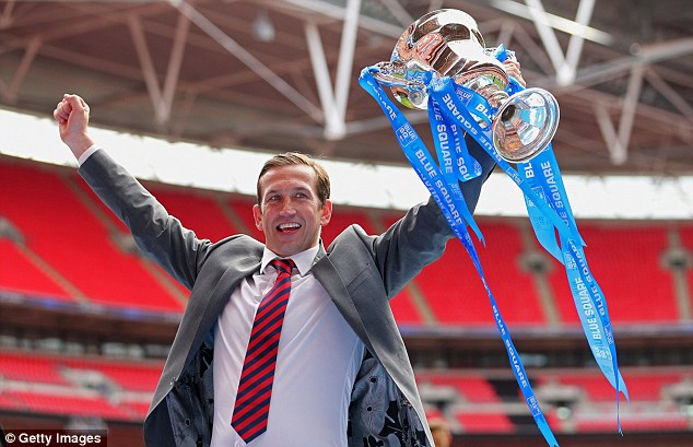 League Two here we come: Newport manager Justin Edinburgh throws his hands aloft