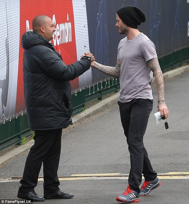 Merci: David said thank you to a member of staff at the training ground before heading on his way