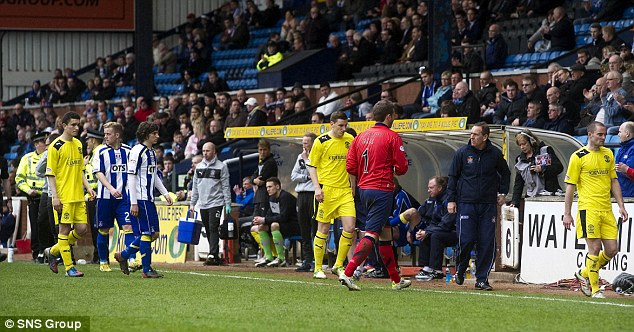 Abandoned: The players are led back to the changing rooms. The game was called off after 54 minutes, with supporters of both teams applauding the decision