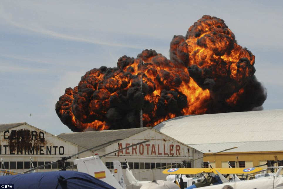 Explosion: A plane crashed at an airshow in Madrid today, sending a giant fireball into the sky and severely injuring the pilot who later died in hospital in Madrid