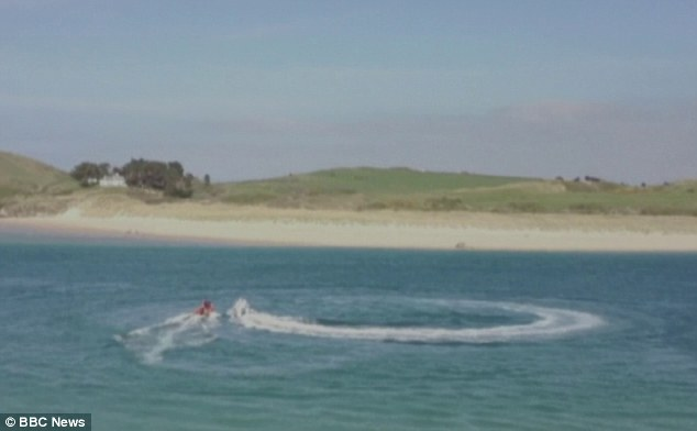 Bravery: The video, filmed from the shore, shows the unidentified man jumping on to the speedboat