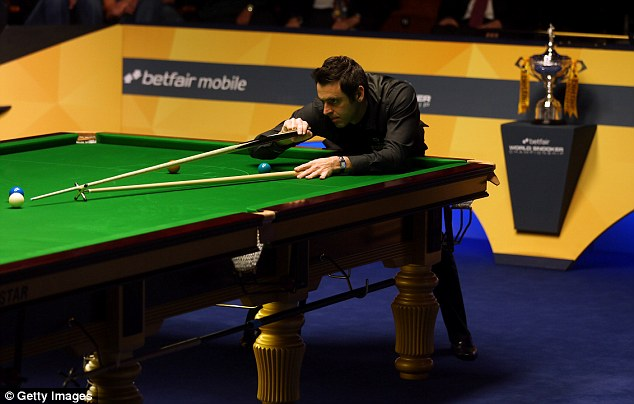 Ahead: Ronnie O'Sullivan will take a 10-7 lead into the third session of the World Snooker Championship final