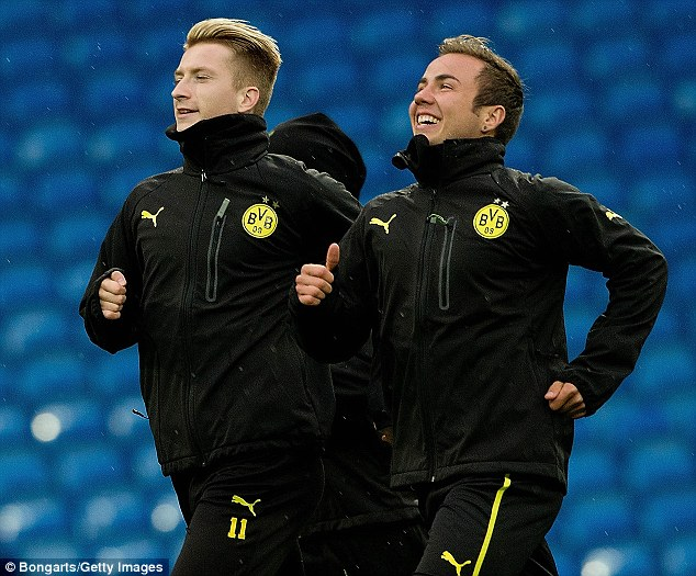 Star man: Mario Gotze (right) is leaving Borussia Dortmund for Bayern Munich at the end of the season