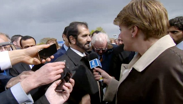 Rare appearance: Sheikh Mohammed (centre) talked on camera after horse Dawn Approach ran a winning race