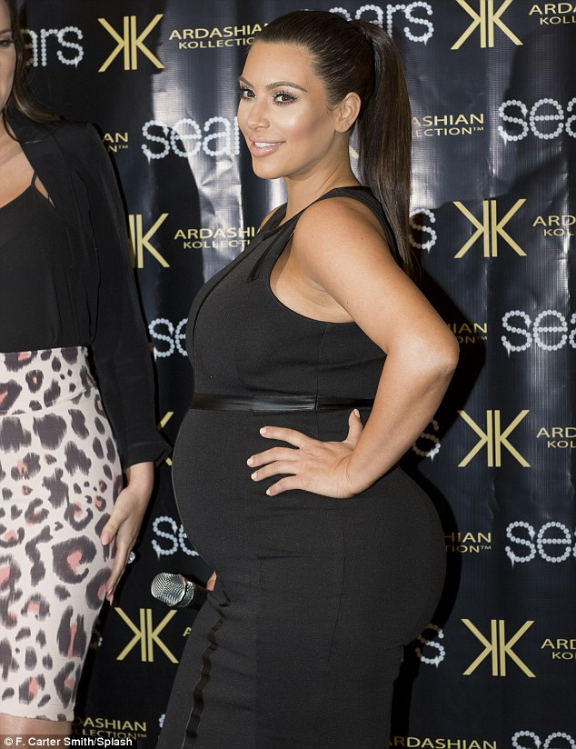 Flaunting it: For her appearance at the Willowbrook Mall, Kim slipped into a skintight black dress that accentuated her every curve