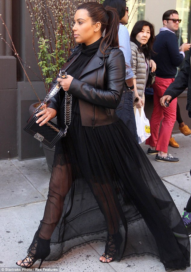 Non-stop: On Saturday, Kim took Texas along with sisters Kourtney and Khloe as they promoted their Kardashian Kollection at a Sears location