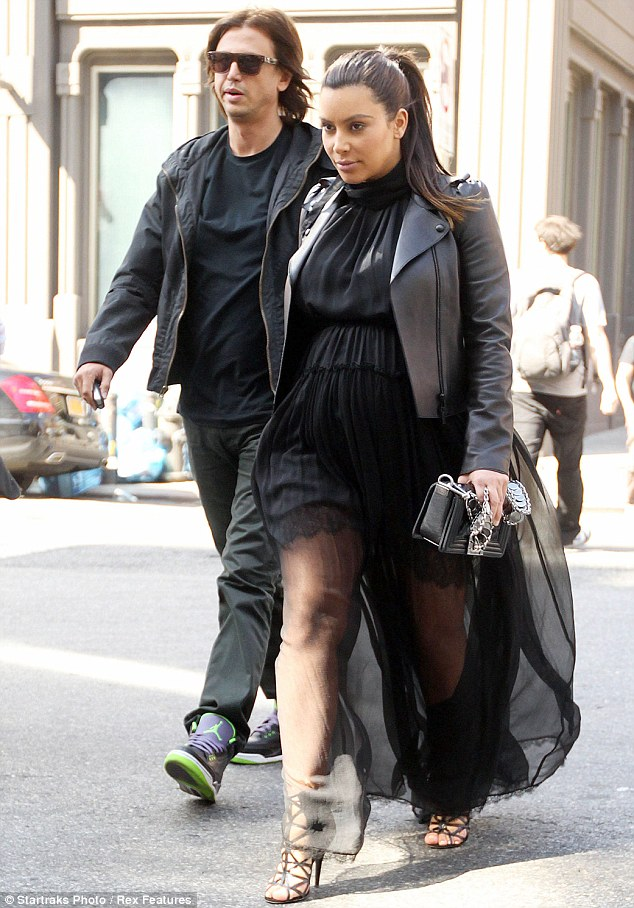 Compromise: For a Sunday afternoon stroll in New York City with pal Jonathan Cheban, Kim Kardashian opted to cover her baby bump but flash some thigh