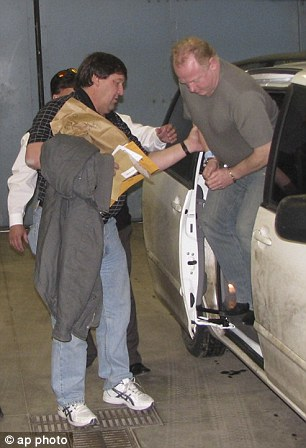 Bebb-Jones exiting a transport van at he arrives after extradition from Britian at Garfield County, Colorado