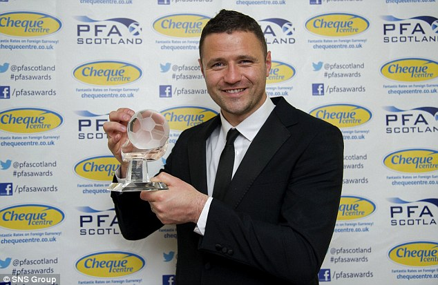 All smiles: Motherwell striker Michael Higdon was named Player of the Year hours before his arrestQ