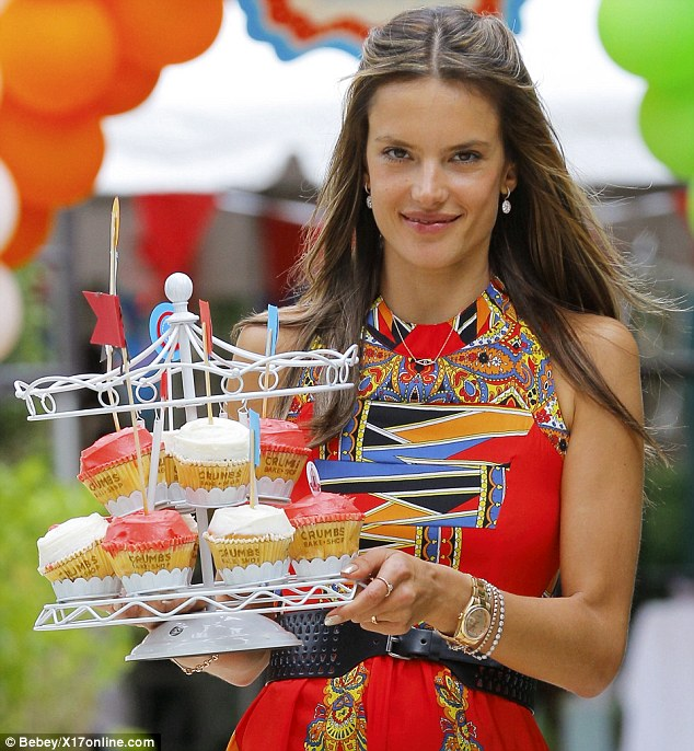 Heavenly vision: Plenty of men would love to see a Victoria's Secret model striding towards them holding a platter of cakes