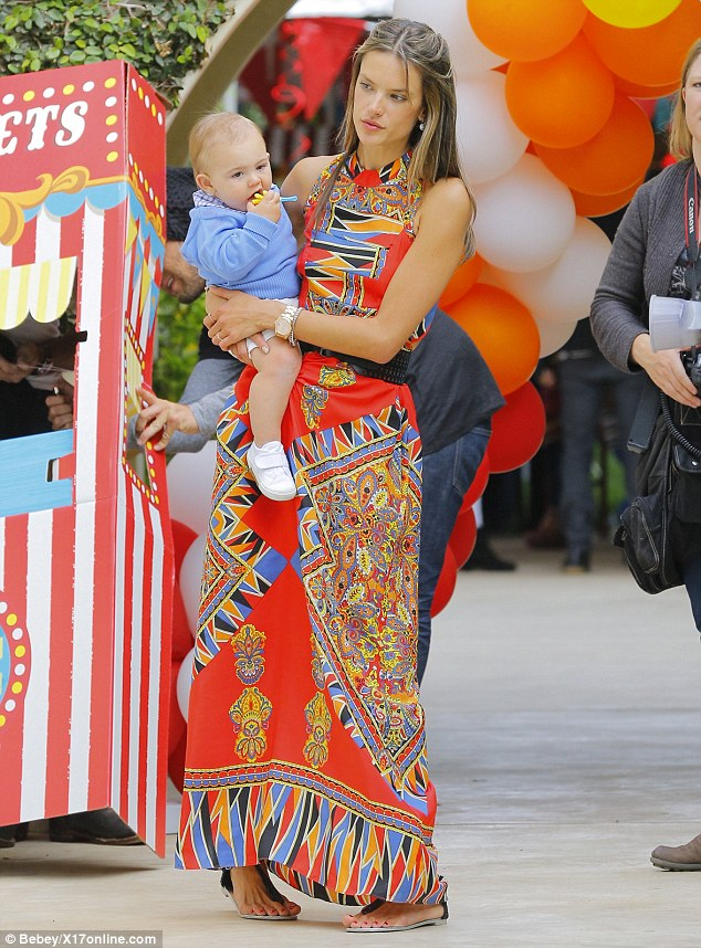 Model mum: The Victoria's Secret model threw her son a big balloon-laden bash complete with cupcakes, lollipops, and a tiny ticket photo-booth