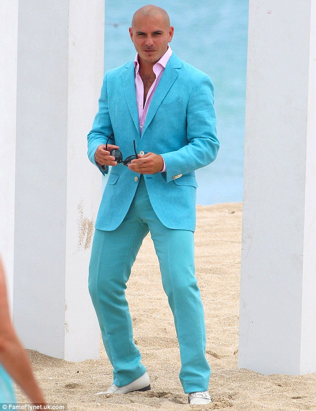 Eye-catching: Pitbull attracts attention in a teal suit